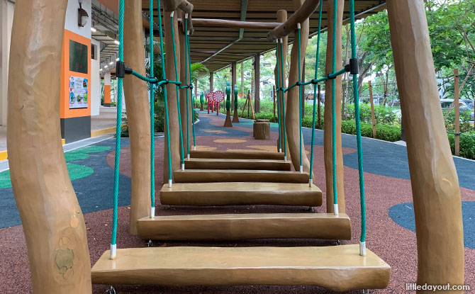 Low wooden plank bridge at The Candy Trail, Clementi