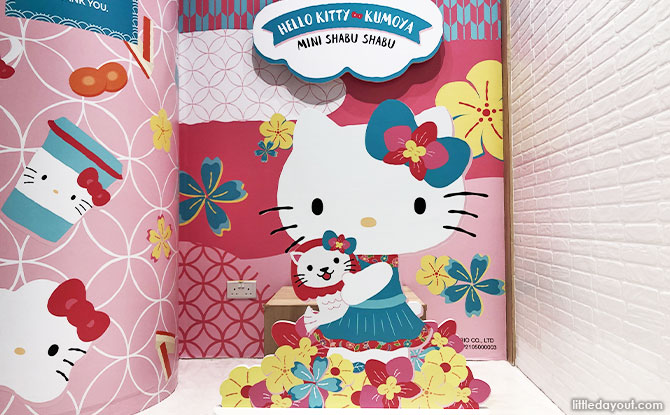 small photo-taking area with Hello Kitty cuddling an adorable baby merlion