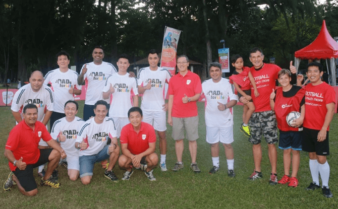Guest-of-Honour Mr Tan Chuan-Jin, Minister for Social and Family Development with the Dads for Life Soccer Team