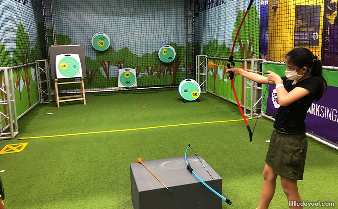 Taking Aim At the Archery Station At SuperPark Singapore