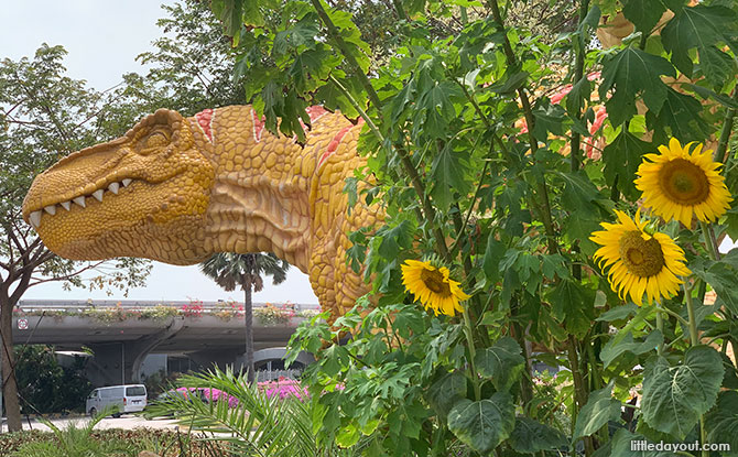 T-Rex hiding amongst the sunflowers