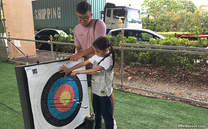 Coach Jian Qi taught us to always have one hand on the target board while pulling the arrow out with the other hand.