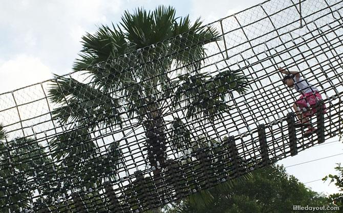 Climbing along the net bridges at Nestopia Singapore
