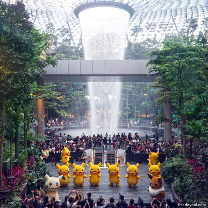 Pikachu, Eevee and Mimikyu dancing at Jewel Changi Airport as part of the Pokemon Parade