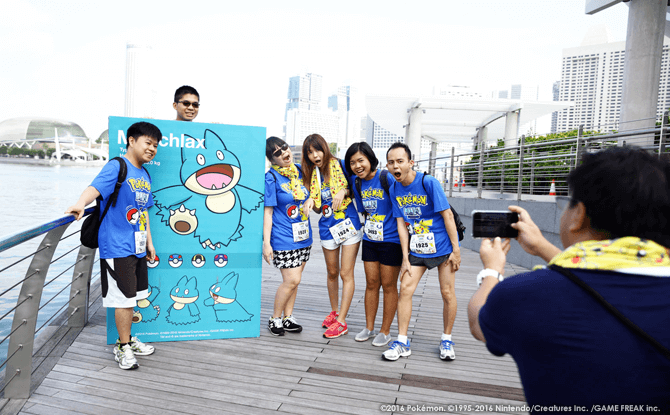 Participants snapping photos along the Pokémon Run route.