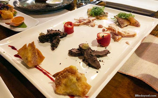 Salt & pepper leaf crocodile and prawns and an Antipasto Plate