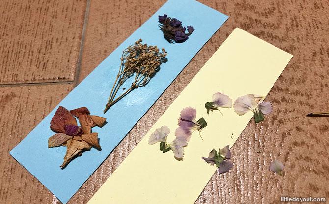 Paste flowers onto paper