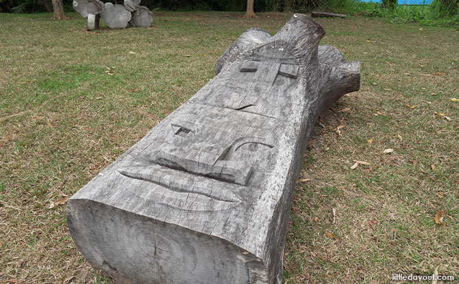 Face Wooden Sculptures In Pasir Ris Park