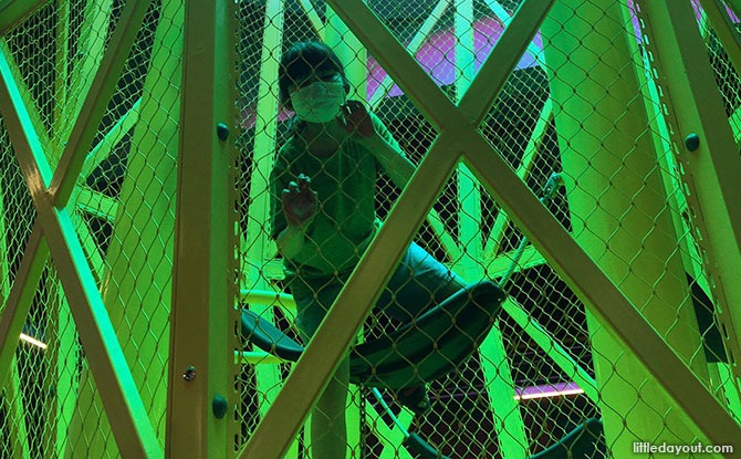 Climbing inside the Timbre+ Eastside Playground