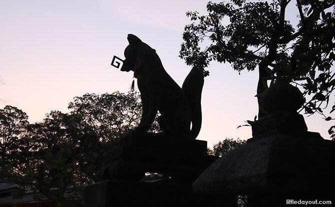 Fox Holding the Key Foxes at Fushimi Inari Shrine