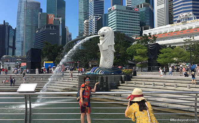 Posing for a picture at Merlion Park, Singapore