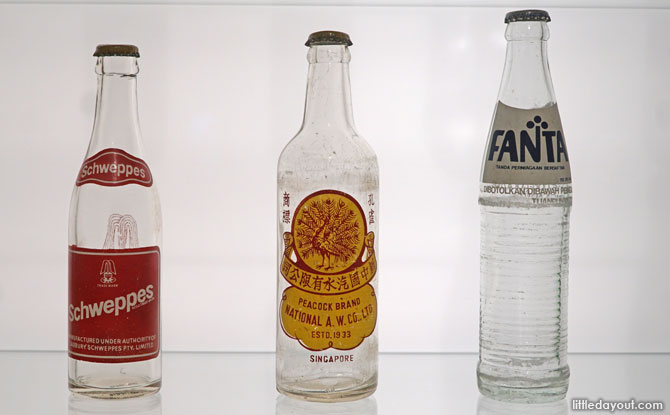 Old bottles at the Food Packaging exhibition, National Museum of Singapore