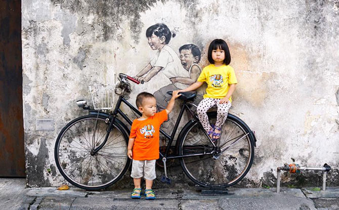 "Little Chow and Littler Chow unhappy about an ""unreal"" bicycle, Penang, Malaysia. Image: Stefan Chow."