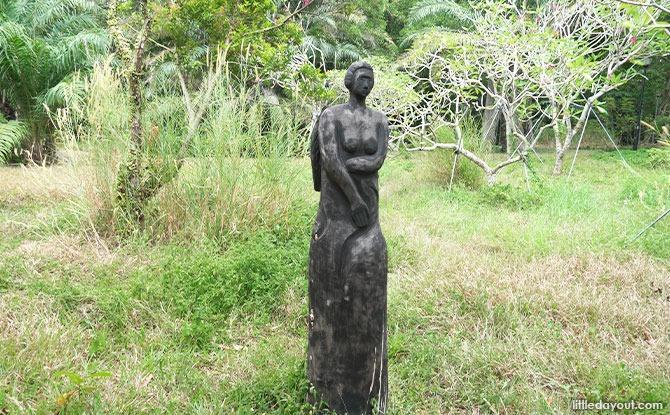 woman Wooden Sculptures In Pasir Ris Park