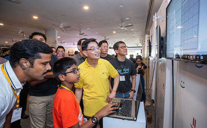 Code in the Community graduate Ramakrishnan Sanjit presenting his project to DPM Heng Swee Keat