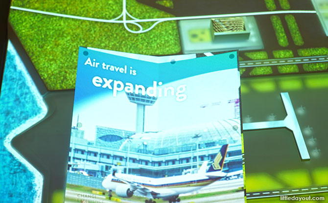 Using the Travel Guide at the Hanging Garden, Changi Experience Studio, Jewel