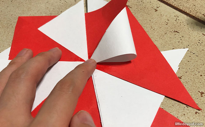 take the outer triangle pieces and fold them inwards