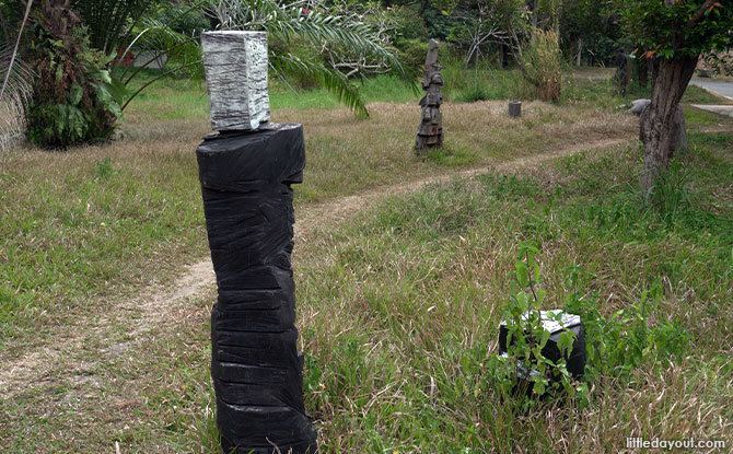 stacked Wooden Sculptures In Pasir Ris Park
