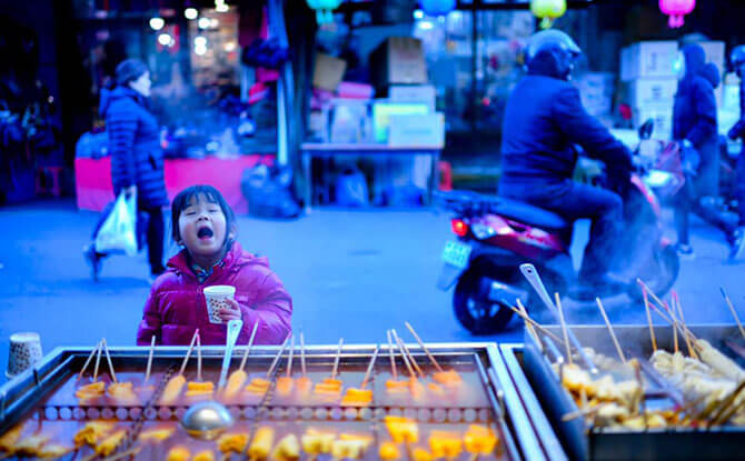 Little Chow discovers the joy of drinking hot soup by the street on a cold winter's day, Daegu, South Korea. Image: Stefen Chow