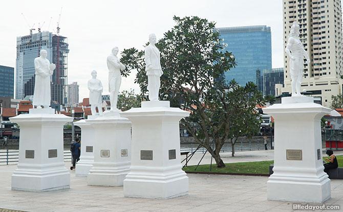 The Arrivals statues along Singapore River