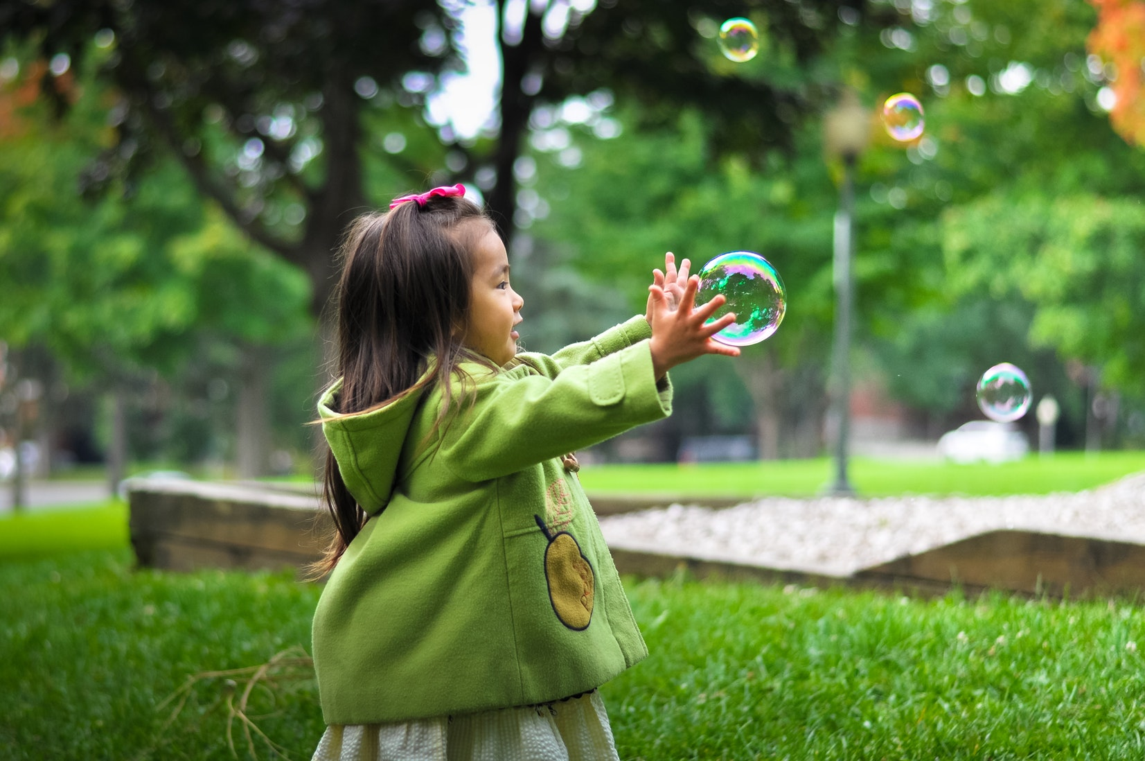 Young girl playing with bubble