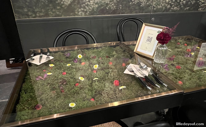 live flower bed on each table