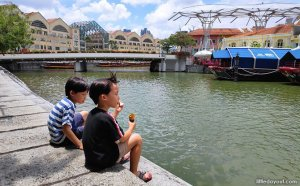 Sitting by the Singapore River