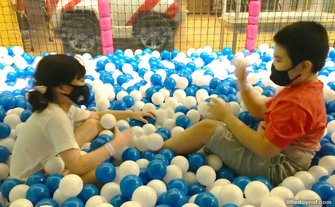 Playing at the T-Play Khatib ball pit