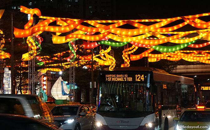 Traffic drives under the lanterns at South Bridge Road.