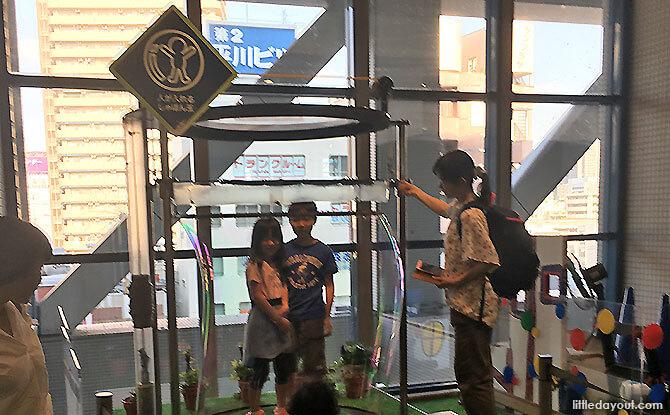 Stand inside a bubble at Kids Plaza Osaka