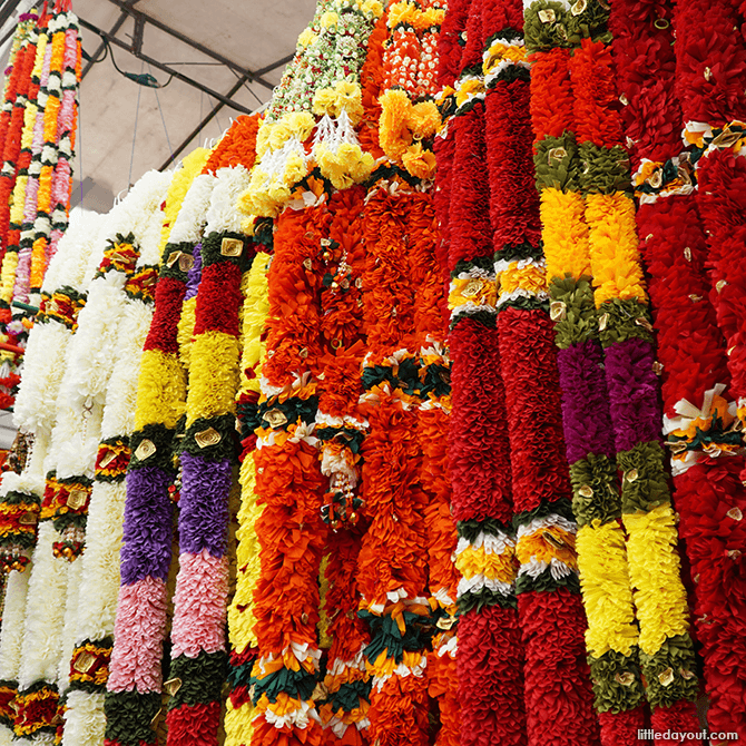 Colourful garlands line the walkway.
