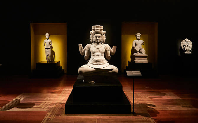A 10th century sculpture of Hindu deity Brahma greets visitors as they enter the second section of the exhibition