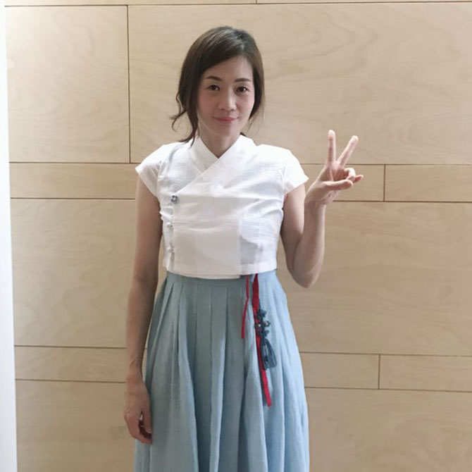 Lee Jee Eun, General Manager of the Korea Tourism Organization Singapore, who is wearing a modern hanbok.