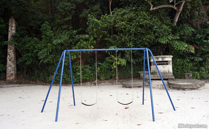 Swings at Labrador Park with a machine gun nest and a navigational marker in the background