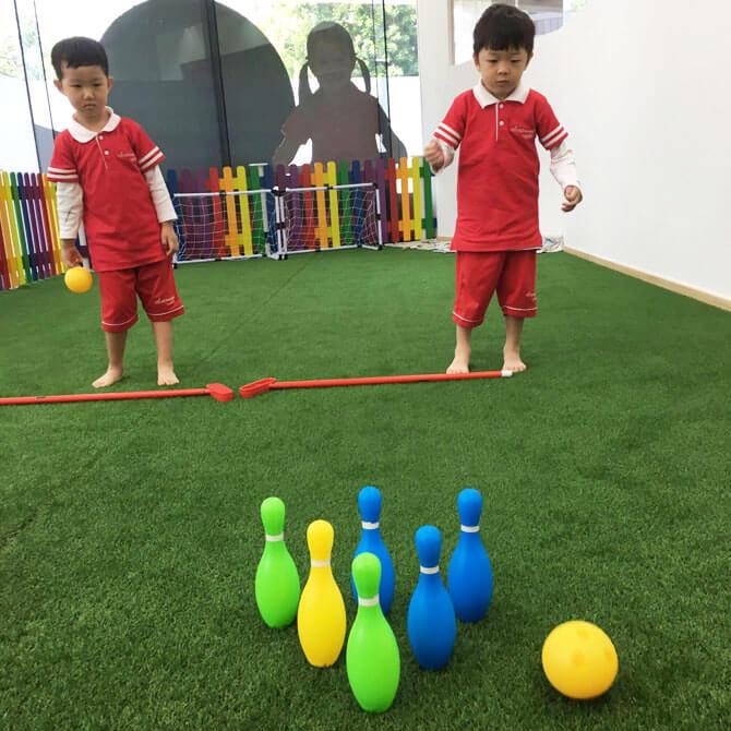Preschoolers at MindChamps Boon Keng (Kallang) bowling