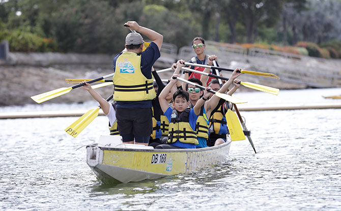 Attendees trying their hand at Dragonboating during the Let's Play event.