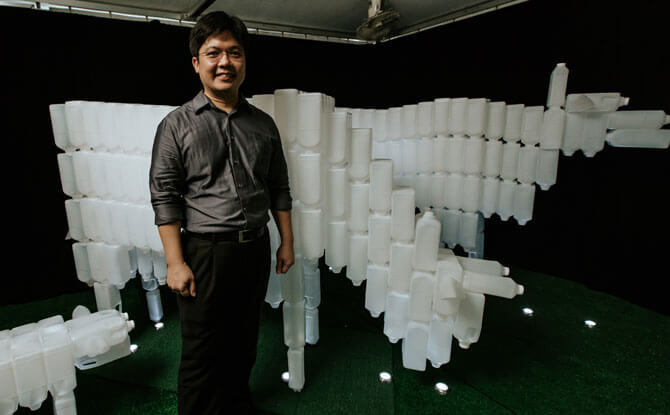 Milk Bottle Cows with its artist, BP Loh. Photo: Colossal Pro