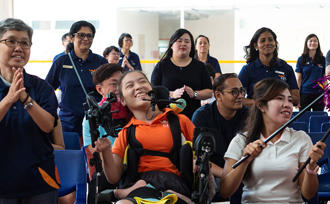 Cerebral Palsy Alliance Singapore (CPAS) Goodwill, Rehabilitation & Occupational Workshop (GROW) trainee Elaine Eng (in orange) at the launch of Steptember 2019.