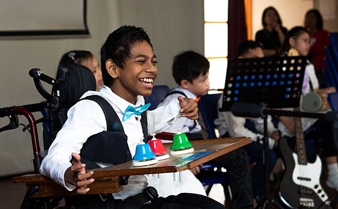 Cerebral Palsy Alliance Singapore (CPAS) School student Md Azim Bin Shaikih Mohamed performing at the launch of Steptember 2019 with schoolmates from the Performing Arts CCA.