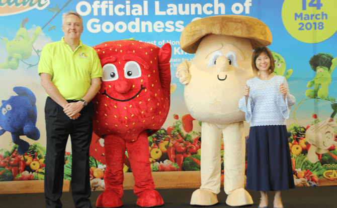 Dr Amy Khor and Mark Herbert with Giant Supermarket's Goodness Gang Mascots