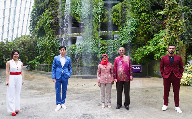 "From left to right: Mediacorp artistes JJ Neo, Desmond Tan, President Halimah Yacob, Mr Mohamed Abdullah Alhabshee, and singer Taufik Batisah at the filming and recording of ""Home"" in Gardens by the Bay's Cloud Forest. Image: Ministry of"