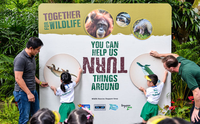 Mr Tan Chuan-Jin and Mr Mike Barclay officially launching the 2018 conservation campaign, Together for Wildlife, with Kinderland kids