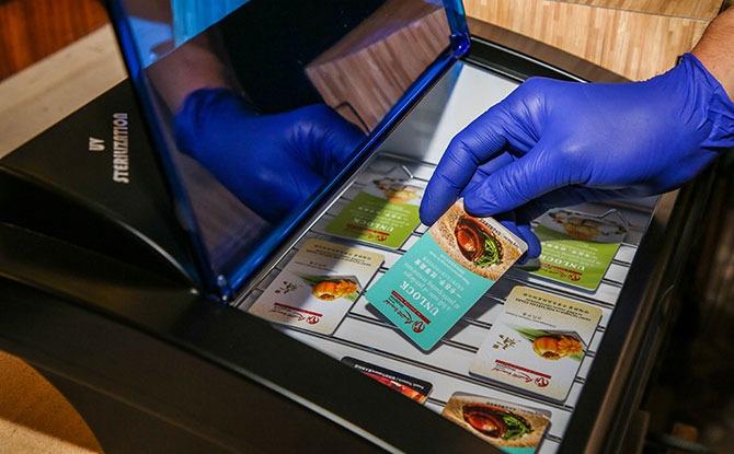 Room key cards are kept in a UV sanitiser