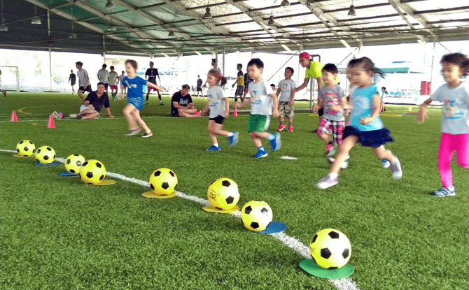 Learning the basics of sports at Ready Steady Go Kids - enrichment classes for preschoolers in Singapore
