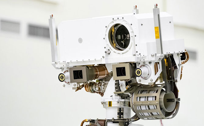 A close-up of the head of Mars 2020's remote sensing mast. The mast head contains the SuperCam instrument (its lens is in the large circular opening). In the gray boxes beneath mast head are the two Mastcam-Z imagers. On the exterior sides of those imagers are the rover's two navigation cameras.
