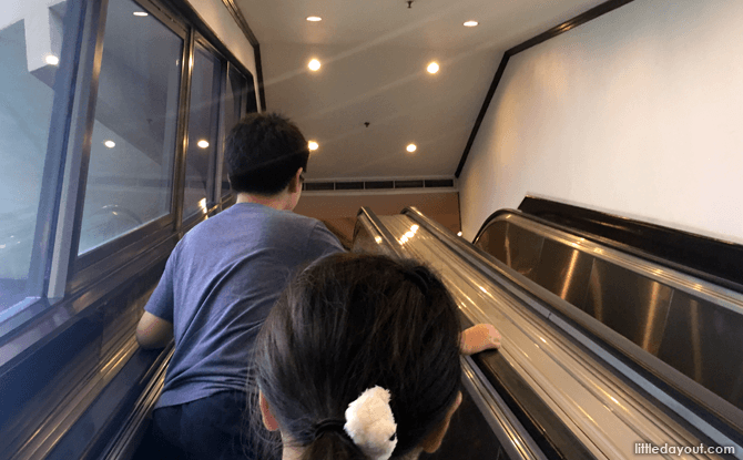 Escalator leading up to the restaurant