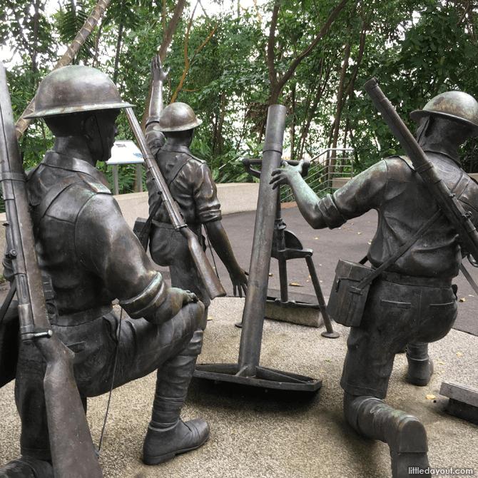 Sculpture of a mortar team at Reflections at Bukit Chandu
