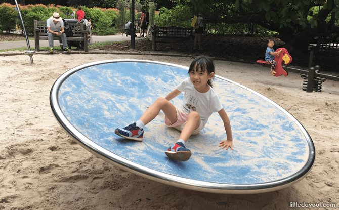 Disc swing at Jacob Ballas Children's Garden's sand play area