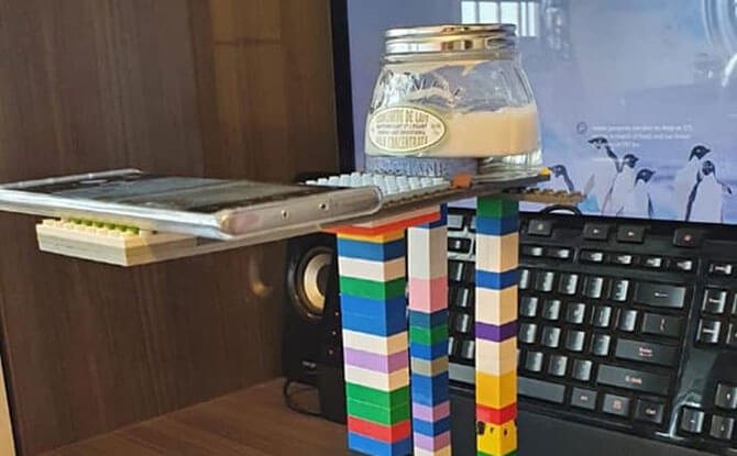 Teacher Creates A Visualiser Using Toy Bricks For Online Lesson