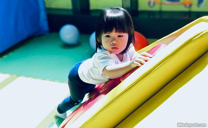 Playing at PLAYtopia, the playground at Tampines Library